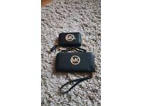 two black mk purses