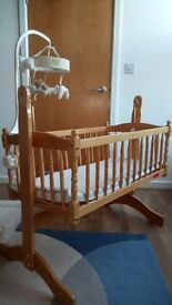 Wooden baby cradle with bedding if wanted.