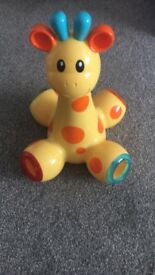 Giraffe popping balls