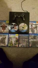 PlayStation 4 slim line with 8 games
