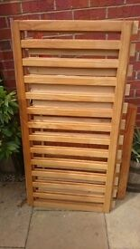Pine cot bed with teething rail