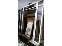 White upvc patio doors - less than 2 years old