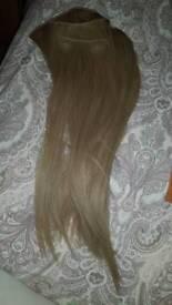 Light blonde clip in hair