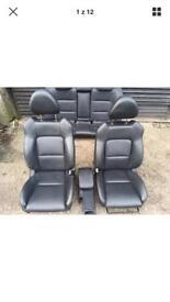 Subaru black leather seats with door cards