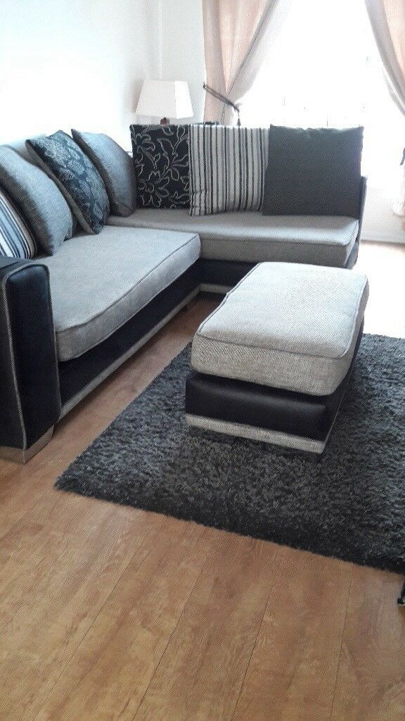 Black and grey corner sofa and large footstool