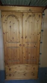 Lovely pine two door wardrobe with drawers for storage at the bottom in good condition
