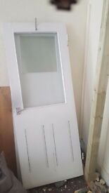 Solid hard wooden door with glass