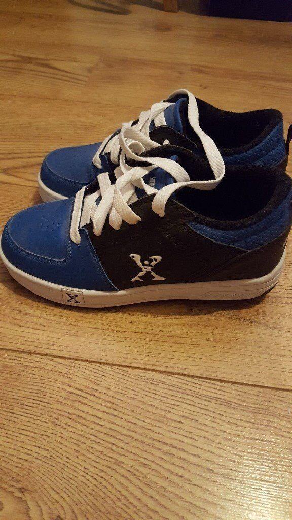 Blue Sidewalk wheelie shoes size 2. Excellent condition.