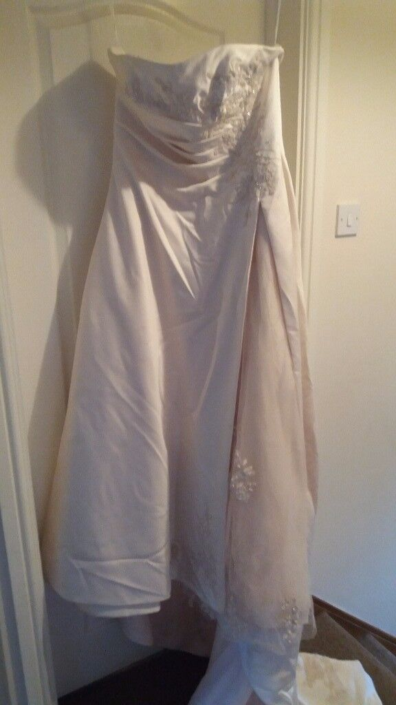Beautiful size 16 wedding dress for sale. Has been dry cleaned. Must be seen to see detail.