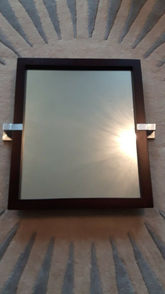 Brown framed wooden mirror