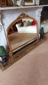 large gold over mantle mirror