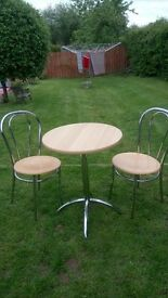 Beech and chrome table and two matching chairs. Bistro set