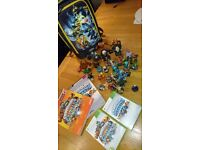 Skylander games, figures, bag and help books