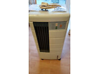 Free standing home air conditioner and humidifer unit (USED and WORKING)