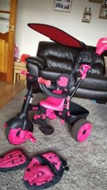 3 in 1 little tikes trike. Pink. Perfect condition. Comes with matching bag and seat cover