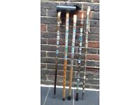 Walking sticks with metal places badges
