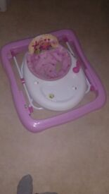 Baby walker, pink- in great condition. 2x height settings