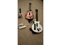 Nintendo Wii w/Controller, Memory Card and Two Guitar Hero Guitars.