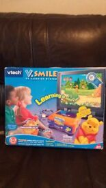 vtech v smile console , art studio , dance n learn , with 7 games cartridges.