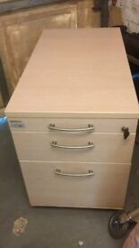 3 drawer wooden filing cabinet/under desk pedestal, with key to lock drawers.