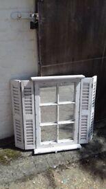 Shabby sheet white shutter mirror