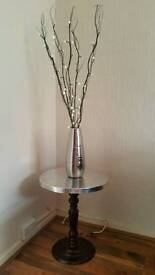 Wood and silver beaten metal finish side table and twig lights in silver vase