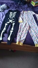 2 girls onesies age 6/7. Minion & Skeleton glow in the dark. From no smoking/pets house
