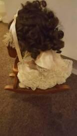 Leonardo collection porcelain doll on rocking horse