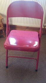 Pink fold away chair