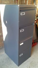 Four drawer grey metal filing cabinet with key, takes A4 files, some dividers available