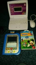 Storio with Toy Story 3, Micky Mouse Club House story games and Adapter also a Scientific computer