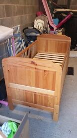 Solid pine cot bed , converts to a junior bed.