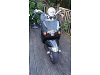 Aprilia Mojito 125 cc, chrome black scooter.