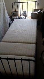 Ikea childrens metal bedframe and mattress.