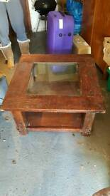 Wooden coffee table with glass insert