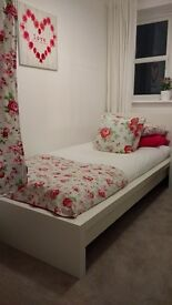 IKEA single white bedframe. Guest bed hardly used.