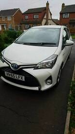 Toyota yaris hybrid icon auto