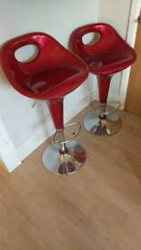Two red barstools. Bargain.