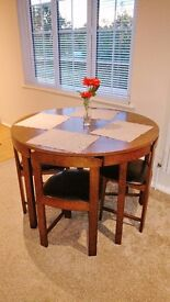 Solid Wood Circular Dining Table with 4 Chairs. Very good condition!