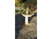 Stone water feature. Fountain run by electric pump. Self contained water suppl