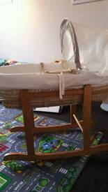 Excellent condition moses basket with stand, bottom sheets and mattress protectors if wanted.