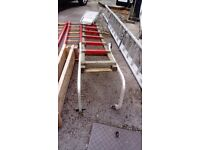 Set of steel extending ladders and other wooden ladders