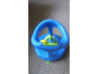 Baby bath seat and microwave sterilizer