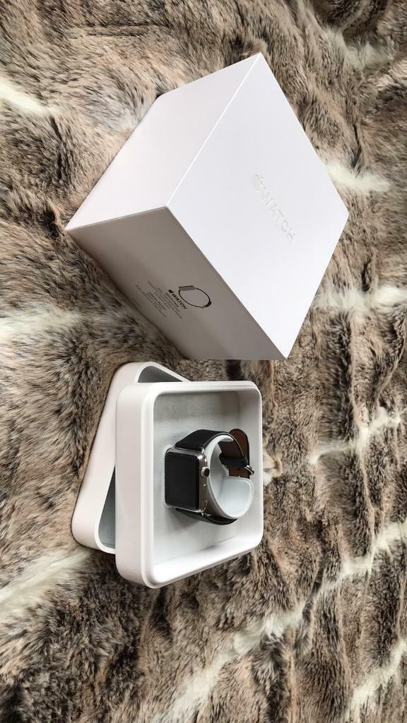 Apple Watch 38mm Stainless Steel with black leather strapin Coalville, LeicestershireGumtree - Apple Watch 38mm stainless steel with classic buckle black leather, used comes with box instructions and charger