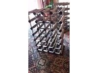 Two heavy wood and metal wine racks