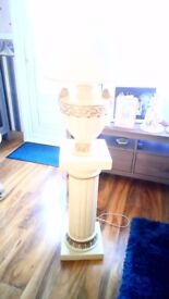 pedestal and lamp and pedestal and vase of flowers