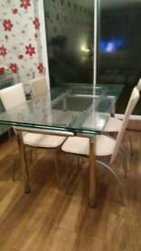 Extending glass dining table and 6 leather chairs with matching sideboard. Both Barker & Stonehouse.