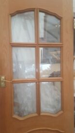 Internal Oak doors with 6 glass panals and mouldings. 2 at 30inches wide & 1 at 28inches