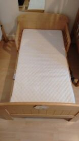 Wooden child's bed