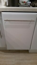 Integrated dishwasher 3/4 size. Full working order. Gloss white door.